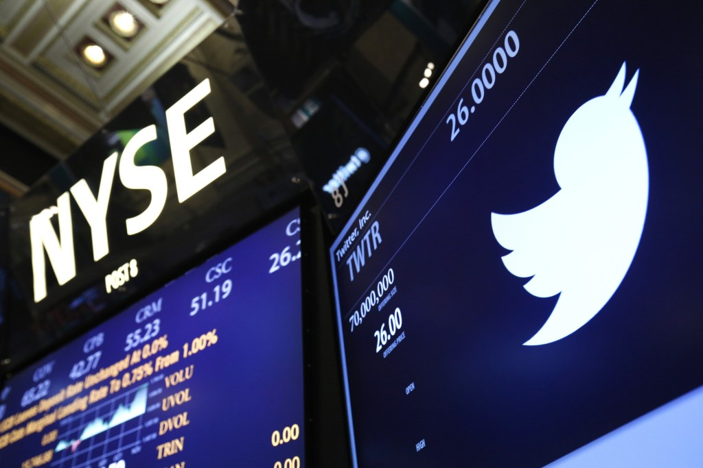 The Twitter logo is seen on the floor at the New York Stock Exchange before the company's IPO in New York, in this file photo taken November 7, 2013. Twitter Inc said on Thursday its revenue in the fourth quarter grew 97 percent, surpassing Wall Street expectations, but the growth rate of its monthly users slowed significantly. REUTERS/Lucas Jackson/Files (UNITED STATES - Tags: BUSINESS)
